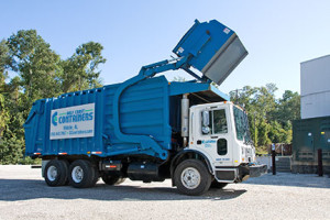 Front load dumpter truck loading a dumpster